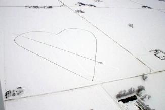 "This Thursday Feb. 11, 2010 photo made available by the Andersland family and taken by Minnesota Aviation, shows an aerial view of a a half-mile wide heart made out of manure 12 miles southwest of Albert Lea, Minn.. Bruce Andersland created the Valentine's Day gift for his wife of 37 years in their farm field. His wife, Beth, says it's the biggest and most original Valentine she has ever received. She says some people might think it's gross but she says it's cute and ""Why not do something fun with what you got?"" (AP Photo/Courtesy of Andersland family - Minnesota Aviation, Darren Schone)"